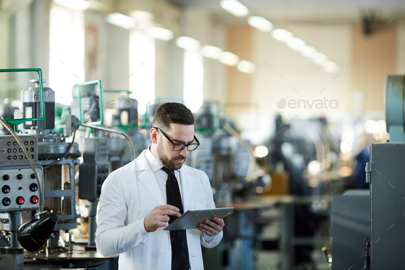 Handsome Factory Manager Using Tablet - Stock Photo - Images