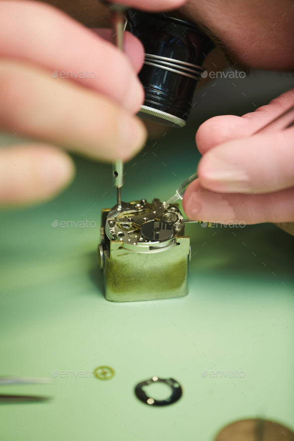Clockmaker Repairing Watch - Stock Photo - Images