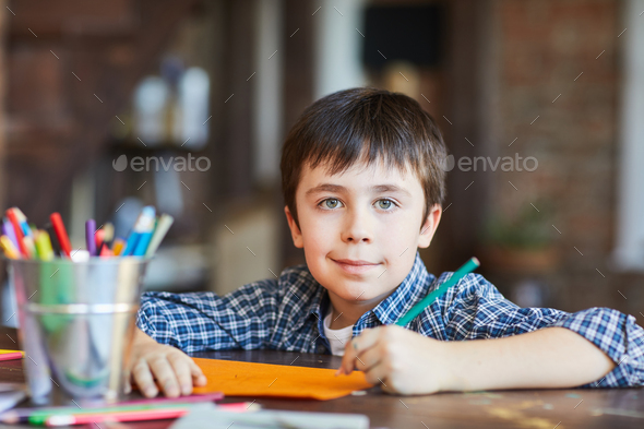 Boy Drawing Pictures - Stock Photo - Images