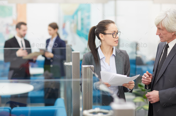 Two Coworkers Discussing Ideas - Stock Photo - Images
