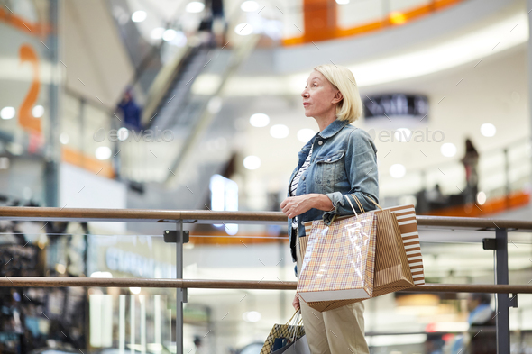 Lost woman in big shopping mall - Stock Photo - Images