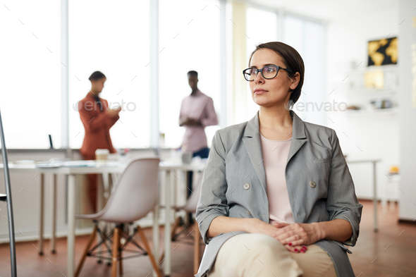Pensive Businesswoman Sitting on Chair - Stock Photo - Images