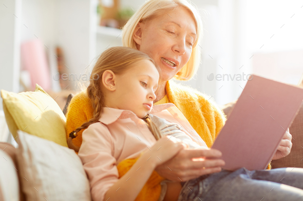 Mother Reading Stories in Sunlight - Stock Photo - Images