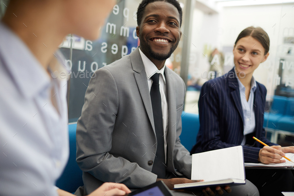 Smiling African Businessman in Meeting - Stock Photo - Images