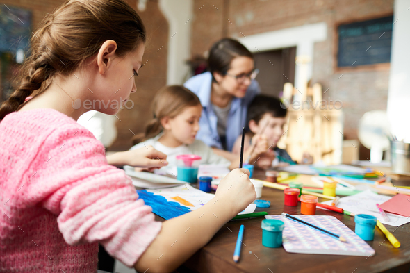 Back View of Girl Painting in Art Class - Stock Photo - Images