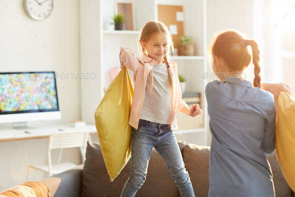 Girls Playing Pillow Fight - Stock Photo - Images