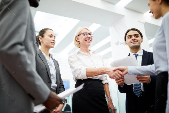 Female Boss Greeting Partner - Stock Photo - Images