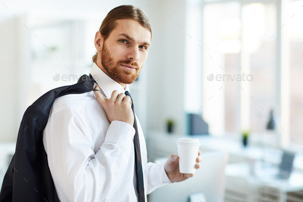 Businessman with drink - Stock Photo - Images