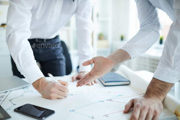 Engineers over sketch - Stock Photo - Images