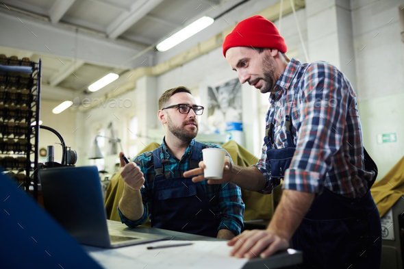 Two Mature Men Working at Factory - Stock Photo - Images