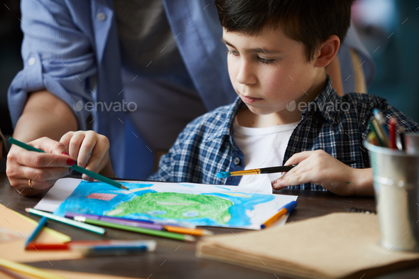 Closeup of Boy Drawing Pictures with Mom - Stock Photo - Images