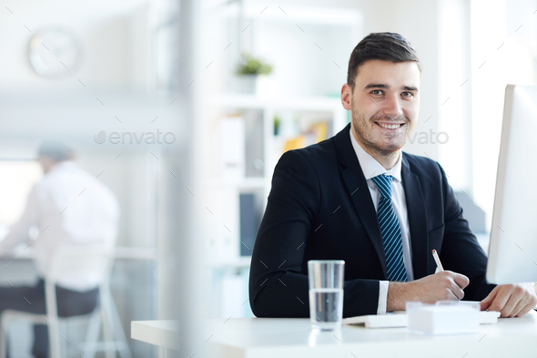 Businessman by workplace - Stock Photo - Images
