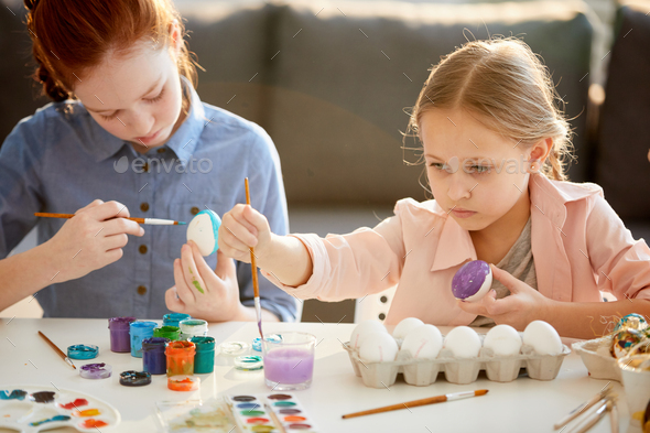 Girls Painting Easter Eggs - Stock Photo - Images