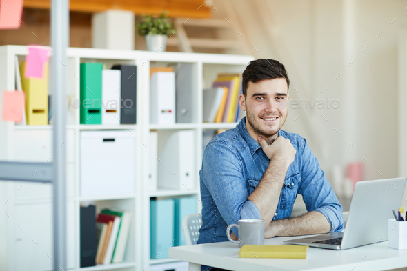 Employee by workplace - Stock Photo - Images