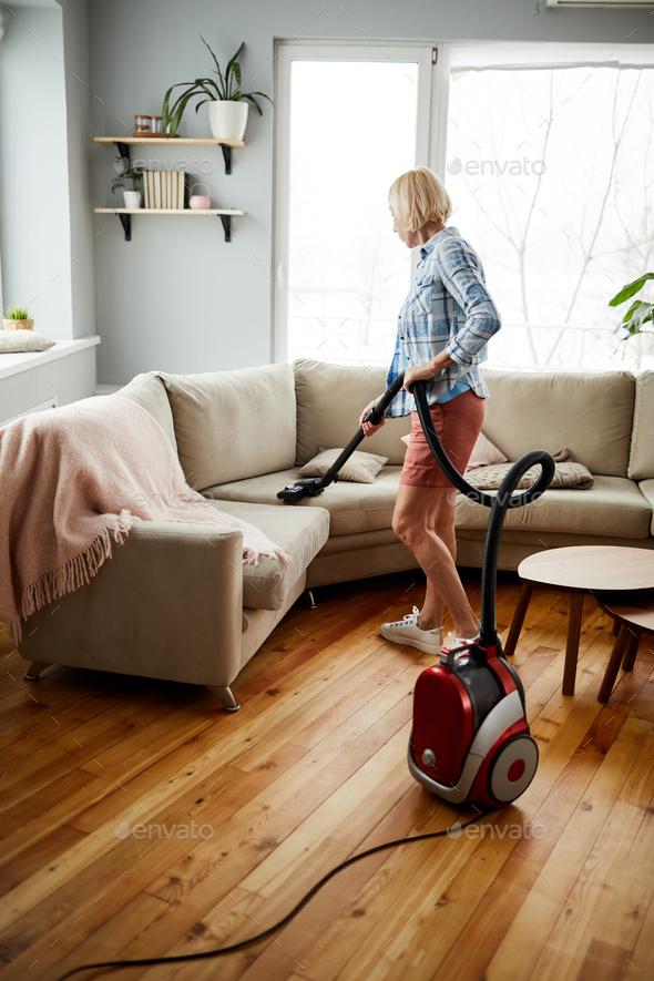 Vacuuming sofa - Stock Photo - Images