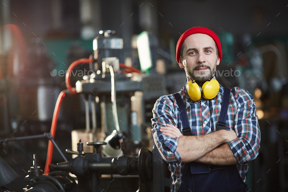 Worker Posing at Plant - Stock Photo - Images
