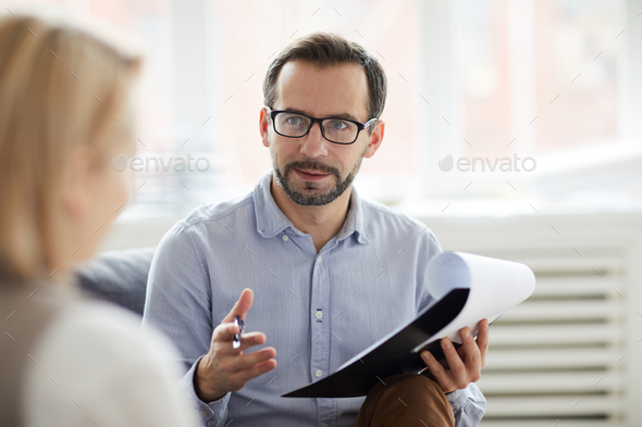 Discussing problem of patient - Stock Photo - Images