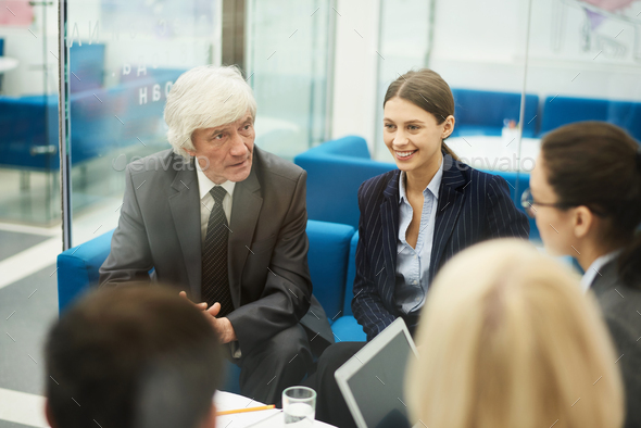 White haired Businessman in Meeting - Stock Photo - Images
