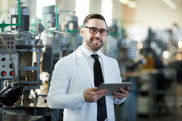 Handsome Factory Manager Holding  Tablet - Stock Photo - Images