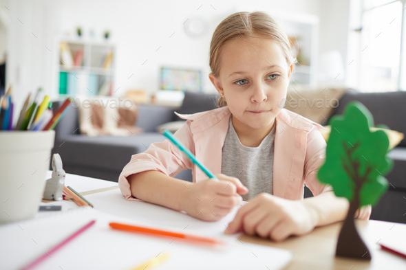 Little Girl doing Homework - Stock Photo - Images
