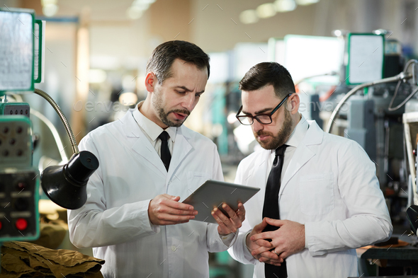 Two Workers at Modern Production Factory - Stock Photo - Images