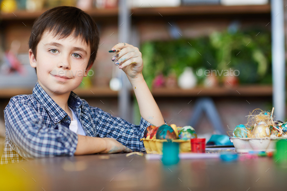 Boy Painting Eggs for Easter - Stock Photo - Images