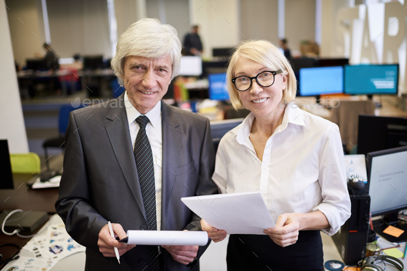 Two Mature Executives Posing in Office - Stock Photo - Images