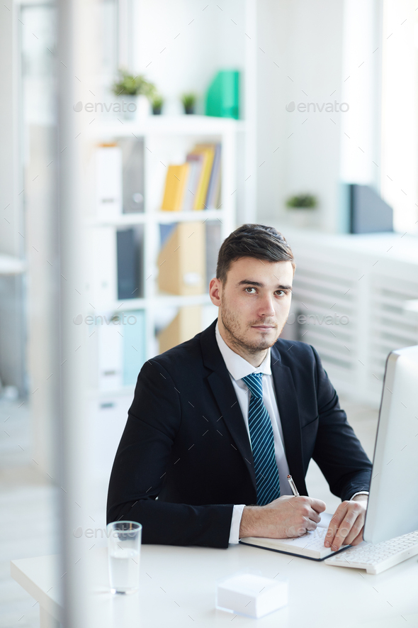 Businessman making notes - Stock Photo - Images