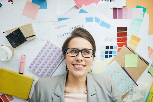 Businesswoman in Office Mess - Stock Photo - Images