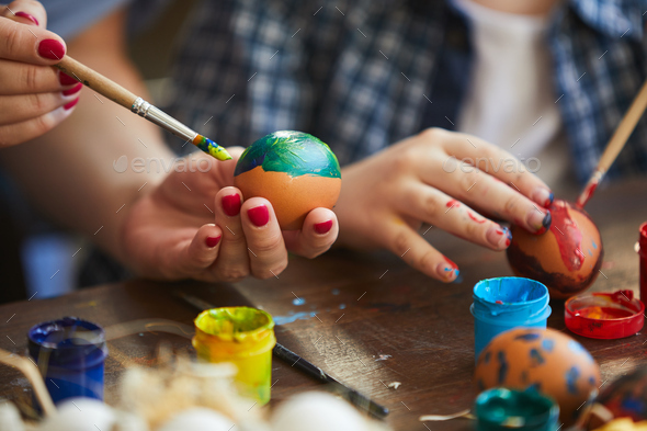 Mother and Child Painting Easter Eggs - Stock Photo - Images