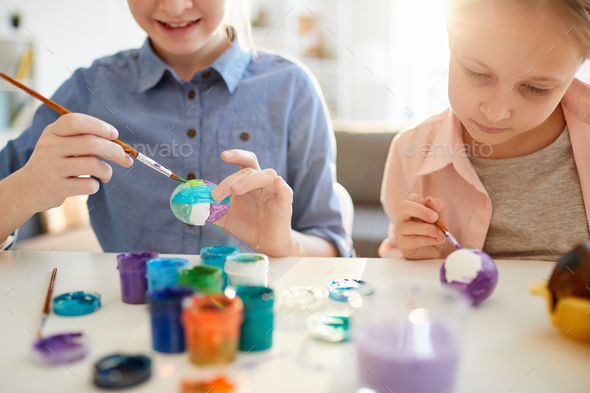Girls Painting Eggs for Easter Close Up - Stock Photo - Images