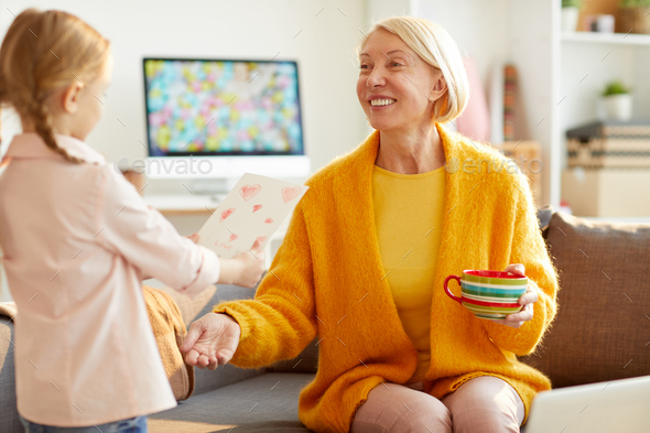 Cute Girl Giving Card to Mom - Stock Photo - Images