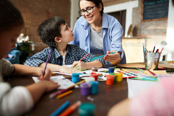 Female Art Teacher Working with Kids - Stock Photo - Images