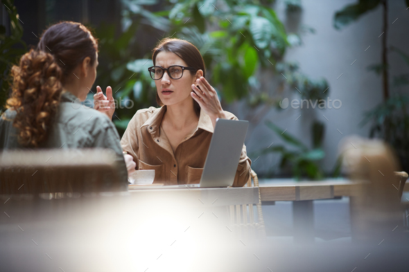 Ladies brainstorming about business project - Stock Photo - Images