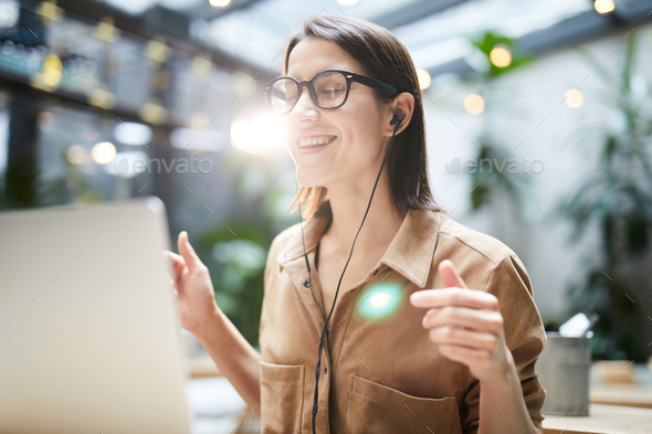 Relaxed woman listening to music in earphones - Stock Photo - Images