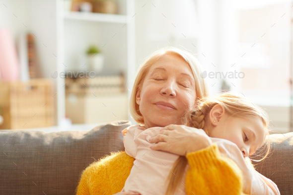 Loving Mother Embracing Daughter - Stock Photo - Images