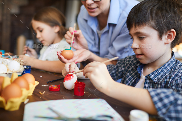 Kids Painting Easter Eggs - Stock Photo - Images