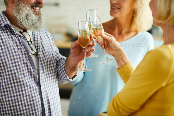 Clinking flutes together - Stock Photo - Images