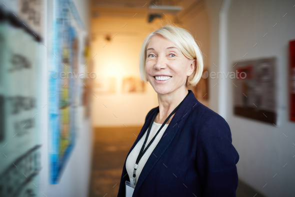 Smiling Woman in Art Gallery - Stock Photo - Images