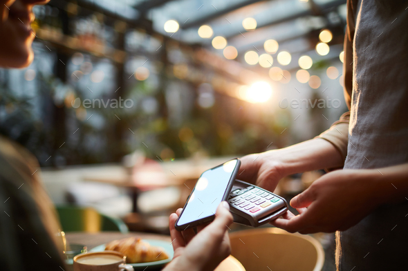 Using smartphone for online payment - Stock Photo - Images