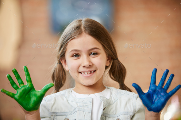 Girl Having Fun with Paint - Stock Photo - Images