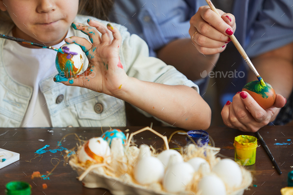 Litte Girl Painting Easter Eggs Closeup - Stock Photo - Images