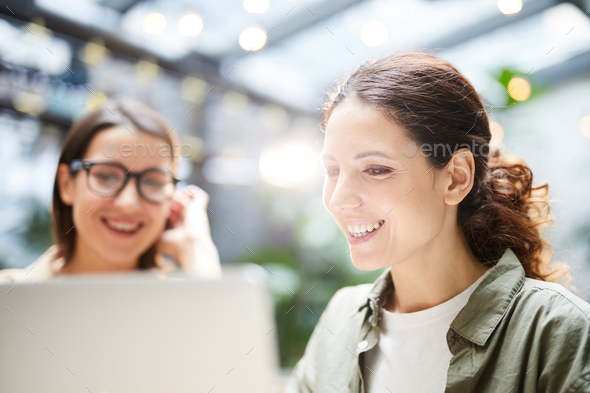 Lady programmers creating landing page - Stock Photo - Images