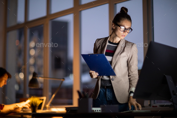 Woman by computer - Stock Photo - Images