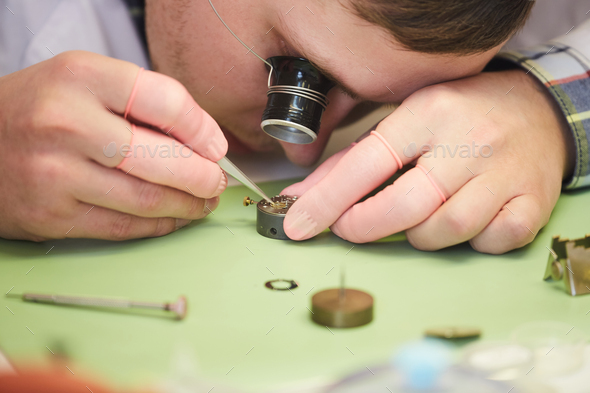 Clockmaker Fixing Watch - Stock Photo - Images