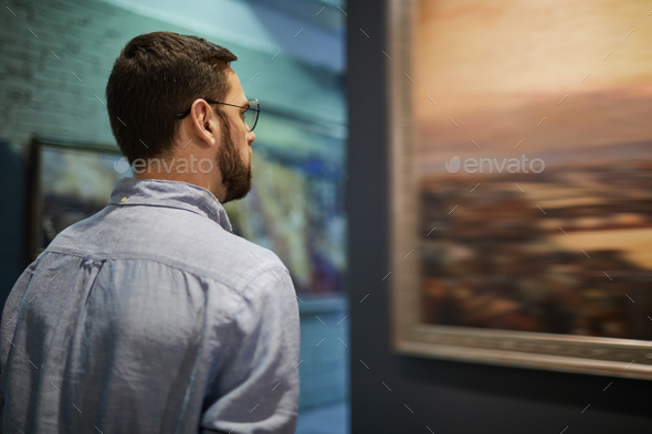 Looking at Classical Painting - Stock Photo - Images