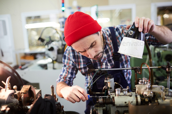 Worker Repairing Machines at Factory - Stock Photo - Images