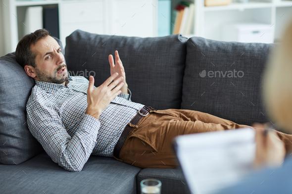 Man explaining problem - Stock Photo - Images