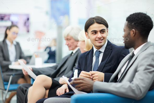 Young Office Workers Talking - Stock Photo - Images