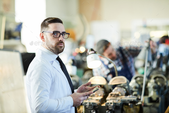 Factory Manager Holding  Tablet - Stock Photo - Images